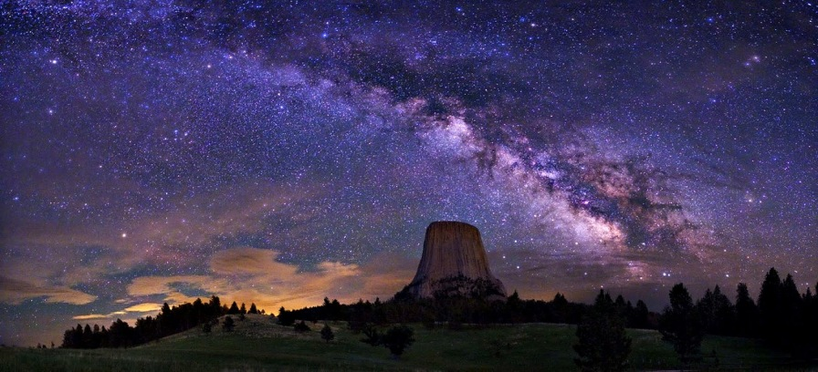 Part of the Milky Way as seen from Earth (Devil's Tower, Wyoming in the United States of America).