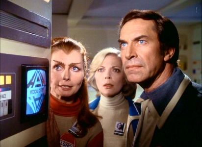 Maya, Helena and John watch events unfold.