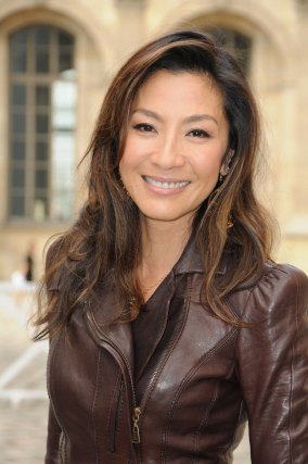PARIS - OCTOBER 07: Michelle Yeoh poses as she arrives for the Louis Vuitton Pret a Porter show as part of the Paris Womenswear Fashion Week Spring/Summer 2010 at Cour Carree du Louvre on October 7, 2009 in Paris, France. (Photo by Pascal Le Segretain/Getty Images)