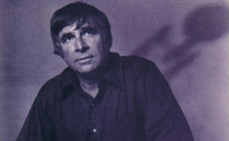 Gene Roddenberry with the shadow of the Enterprise in the background.