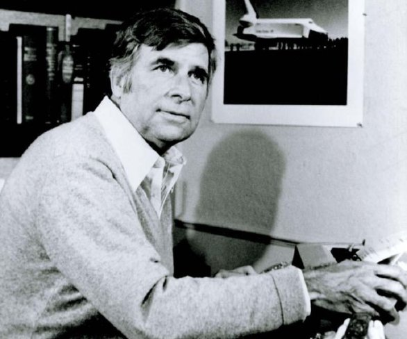 Gene Roddenberry, with the Space Shuttle Enterprise photo in background.