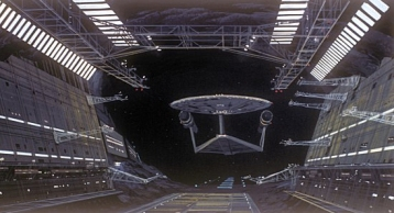 Forward view of the USS Enterprise approaching an asteroid space dock - Ralph McQuarrie.