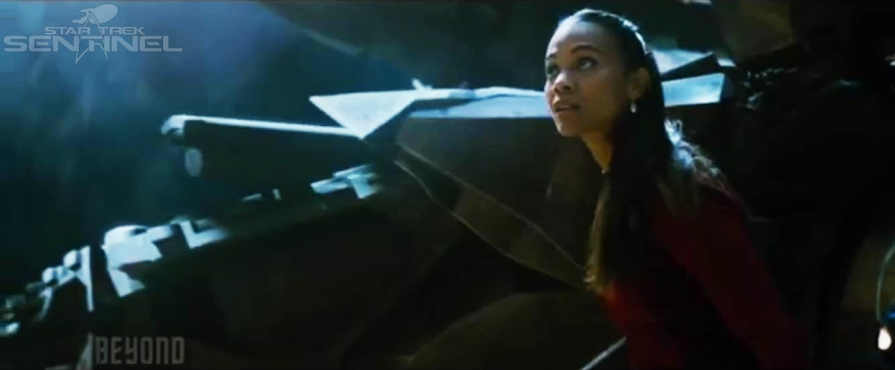 Uhura exits the shattered neck of the USS Enterprise.